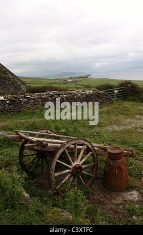 Farm Cart and Old Milk Churn in Rural Ireland - Stock Photo