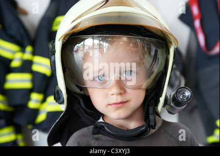 Fire engines, water hoses, nozzles and other equipment at a fire department. Czech Republic - Stock Photo