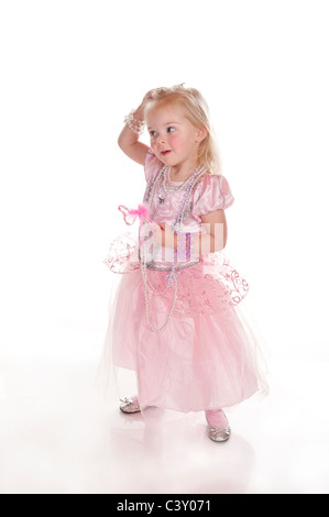 pretty cute little girl dressed in pink princess dress having fun and funny face against white background - Stock Photo