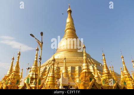 Golden Stupas or Pagodas at the Buddhist Temple of Shwedagon Paya in Yangon, Myanmar - Stock Photo