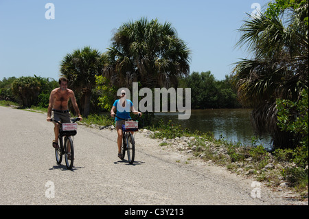 Cyclists in the JN 'Ding' Darling National Wildlife Refuge on Sanibel Island Florida USA - Stock Photo