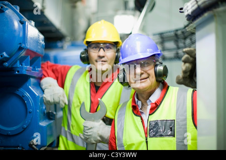 2 workers in engine room - Stock Photo