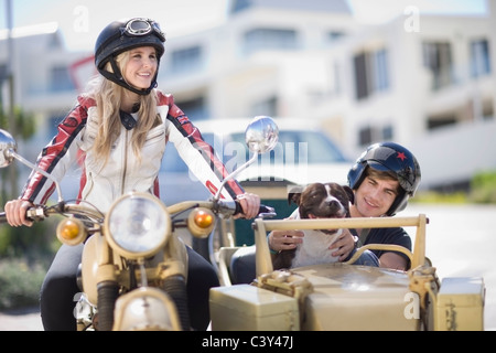 Couple riding a motorbike - Stock Photo