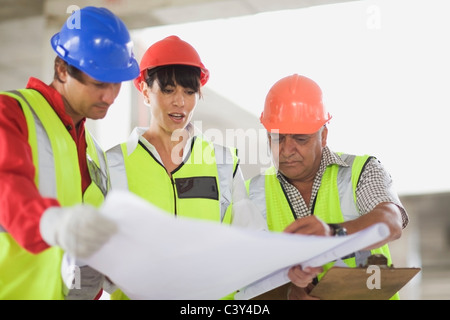 Architect showing construction plans - Stock Photo
