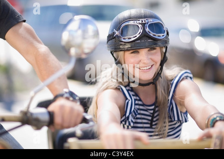 Woman on a motorbike - Stock Photo