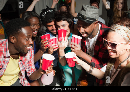 Young people with plastic cups at party - Stock Photo