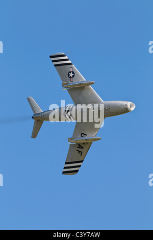 A classic veteran jet fighter of the USAF - The North American F86 Sabre fighter in flight - Stock Photo