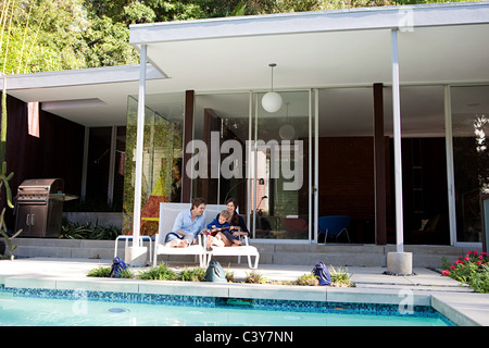 Parents with son at poolside - Stock Photo