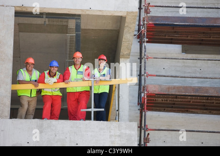 Workers in a shell of building - Stock Photo
