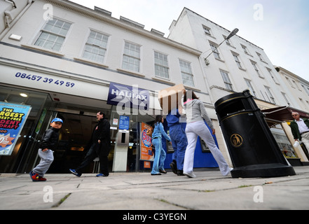 Shoppers passing a branch of the Halifax Bank in Cheltenham UK - Stock Photo