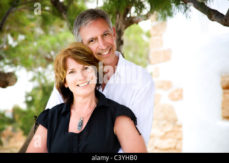 Mature couple smiling and having fun. - Stock Photo