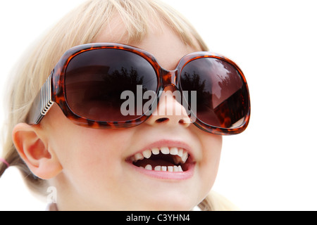 Cute little girl wearing sunglasses. Isolated on white. - Stock Photo