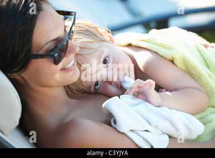 Mother and baby boy resting after pool - Stock Photo