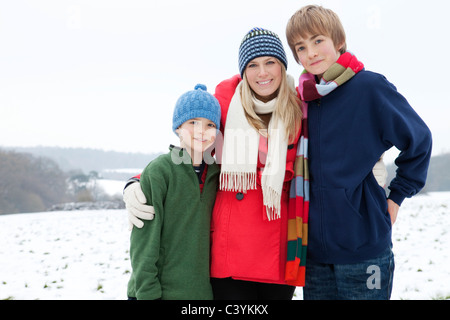 A mother and her sons in the snow - Stock Photo