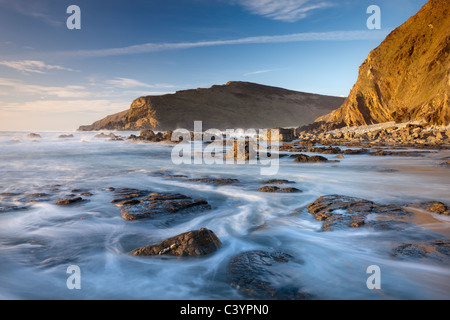 High tide floods the rocky ledges of Duckpool beach on the North Cornish coast, Cornwall, England. Spring (March) - Stock Photo