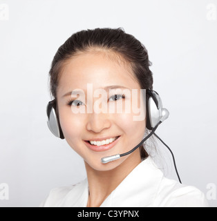 portrait of beautiful asian Customer Representative with headset - Stock Photo