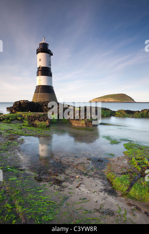 Penmon Point lighthouse and Puffin Island on the east coast of Anglesey, North Wales, UK. Spring (April) 2011. - Stock Photo