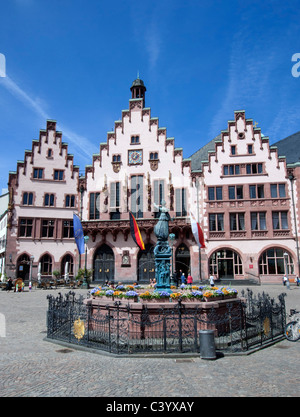 Statue and fountain with Rathaus or Town hall to rear in historic Romerberg Square in Frankfurt Hessen Germany - Stock Photo