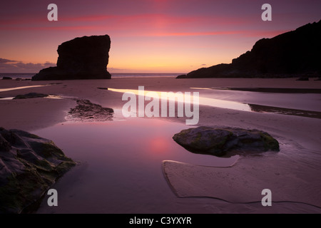 Twilight on the sandy beach at Bedruthan Steps, North Cornwall, England. Spring (May) 2011. - Stock Photo
