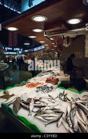 Fresh fish stall in La Boqueria public market, La Rambla (Las Ramblas), Barcelona, Catalunya, Spain - Stock Photo