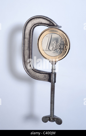 A one Euro coin in a vice - Stock Photo