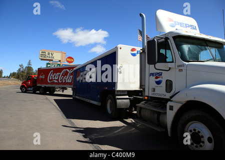 Pepsi and Coca-Cola lorries in an RV Park in Arizona, USA - Stock Photo