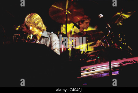 Keith Emerson playing piano and Carl Palmer playing drums in performance with the rock band Emerson, Lake and Palmer. - Stock Photo