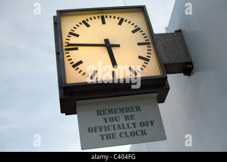 A clock on the deck of a Norwegian Cruise Line Ship - Stock Photo