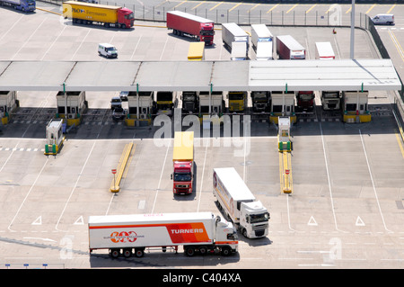 Lorries passing through check in booths before boading cross channel ferries - Stock Photo