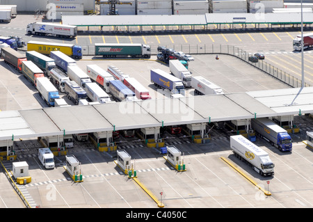 Lorries queuing to check in for boarding channel ferries at Dover Port - Stock Photo
