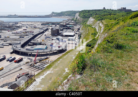 Dover Castle distant shown in relation to the White cliffs and the Dover Ferry Terminal where Rural meets Urban - Stock Photo