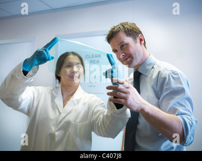 Scientists with finished product - Stock Photo