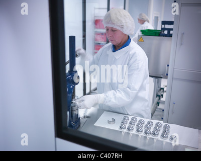 Scientist with product in clean room - Stock Photo