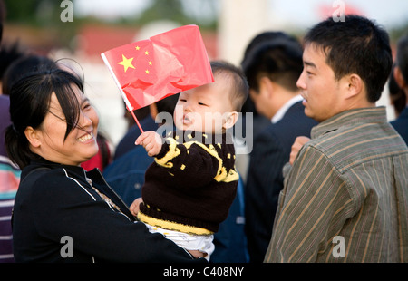 Family in front of Forbidden city, Tiananmen square, Beijing, China - Stock Photo