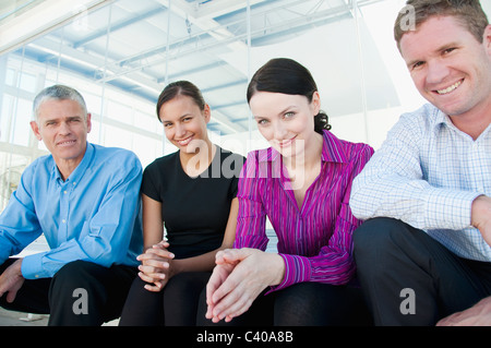 Four happy members of a business team - Stock Photo