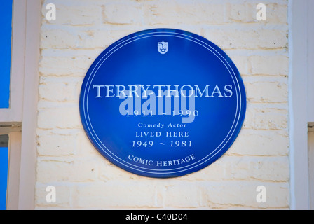 comic heritage blue plaque marking a home of comic actor terry-thomas, in queen's gate mews, south kensington, london, - Stock Photo