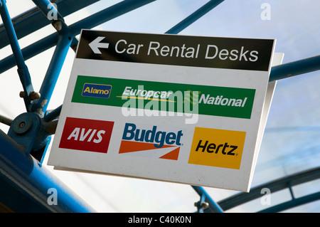 car rental desks of the hertz and budget car rental companies in the stock photo 21737462 alamy. Black Bedroom Furniture Sets. Home Design Ideas