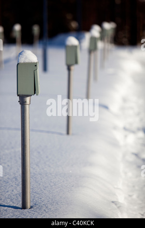 Power outlet posts , for getting electricity for car engine heaters ,  at Finnish parking lot - Stock Photo