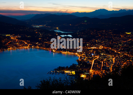 Lugano, Switzerland, Europe, canton Ticino, lake, Lago di Lugano, vantage point, view point, dusk, town, city, illumination, - Stock Photo