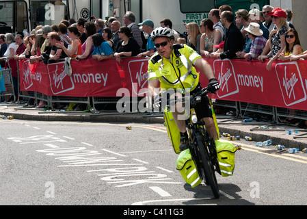 paramedic on a cycle at the Virgin London Marathon - Stock Photo