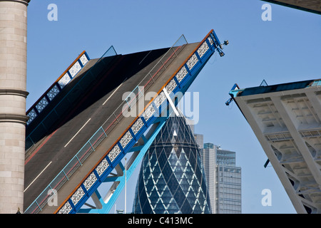 Close-up of grade 1 listed Tower bridge open with the Gherkin in background London England Europe - Stock Photo