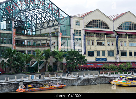 Brewerkz Brewery and Restaurant at Riverside Point near Clarke Quay with River Taxis on Singapore River Republic - Stock Photo