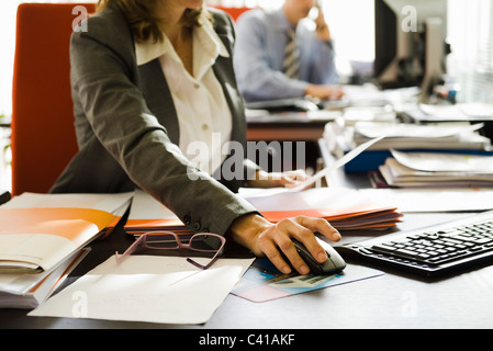 People working in office, cropped - Stock Photo