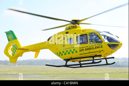 Hampshire and Isle of wight air ambulance helicopter takes off from its base at Thruxton airfield Hampshire - Stock Photo