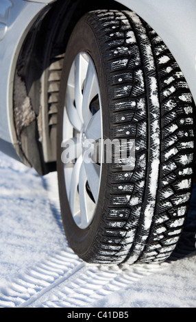 Close-up of a studded car winter tyre - Stock Photo