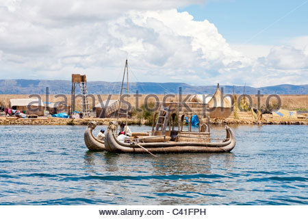 A traditional totora reed boat at the Uros Floating Islands, Lake Titicaca, near Puno, Peru. - Stock Photo