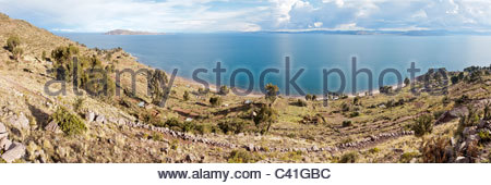 Panoramic view of Lake Titicaca and Isla Taquile, from the Capachica Peninsula, near Puno, Peru. - Stock Photo