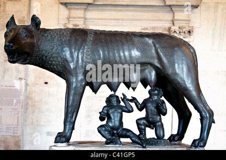 The symbol of Rome- Etruscan bronze statue of the capitoline she-wolf and twins Romulus and Remus in the Capitoline - Stock Photo