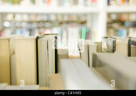 Books on multiple bookshelves, Library, UK