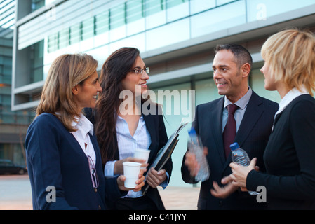 Colleagues taking coffee break outdoors - Stock Photo